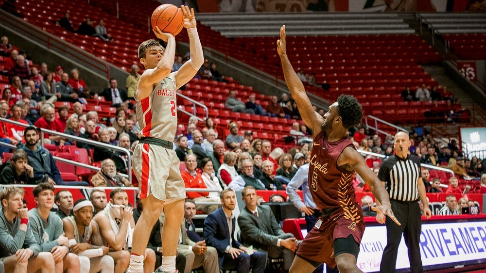 Freshman guard, Luke Bumbalough (2), spots up for a three point attempt against Loyola Chicago Dec. 3, 2019, in John E. Worthen Arena. Bumbalough finished with two three pointers for the night, the Cardinals are now 4-4 on the season after their loss to Loyola. Omari Smith, DN