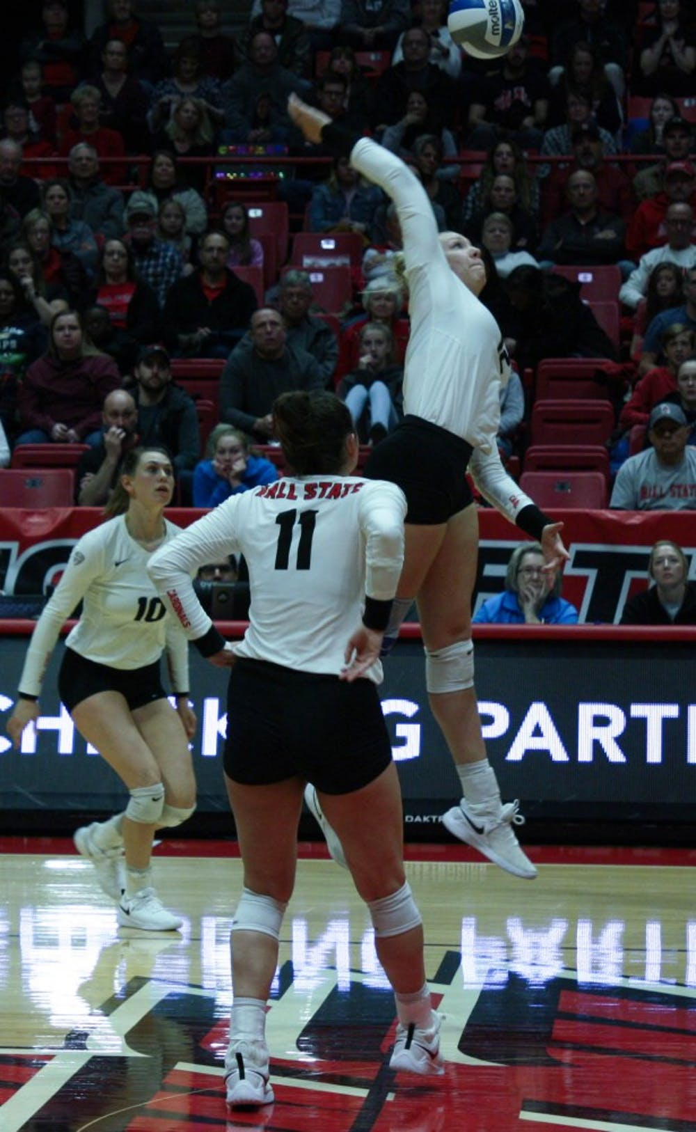 <p>Junior Sydnee VanBeek spikes the ball at the Ball State Women's Volleyball match against Akron Nov.10, 2018, at John E. Worthen Arena. VanBeek scored the winning point of the fifth set to give the Cardinals the match win. <strong>Tailiyah Johnson,DN</strong></p>