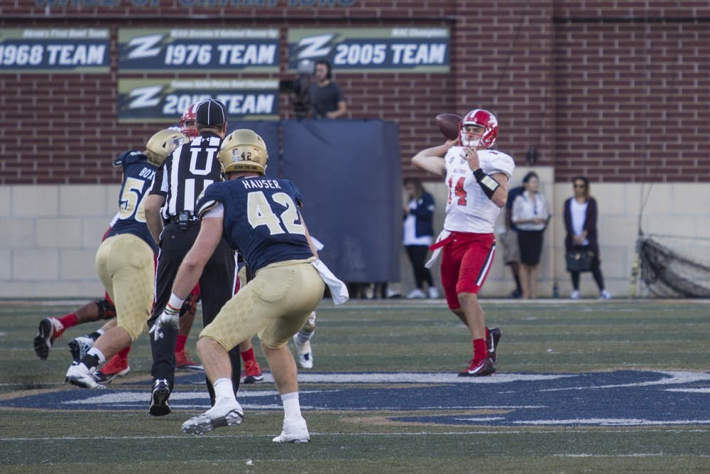 Ball State redshirt senior quarterback Jack Milas's pass is read by Akron redshirt senior linebacker Andrew Hauser in the Cardinals' 31-3 loss Oct. 7. Hauser intercepted the pass. Colin Grylls, DN
