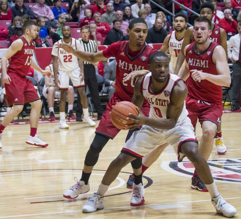 Ball State guard Francis Kiapway attempts to pass the ball to a teammate during the game against Miami on Jan. 10 in Worthen Arena. The Cardinals won 85-74. Terence K. Lightning Jr., DN File