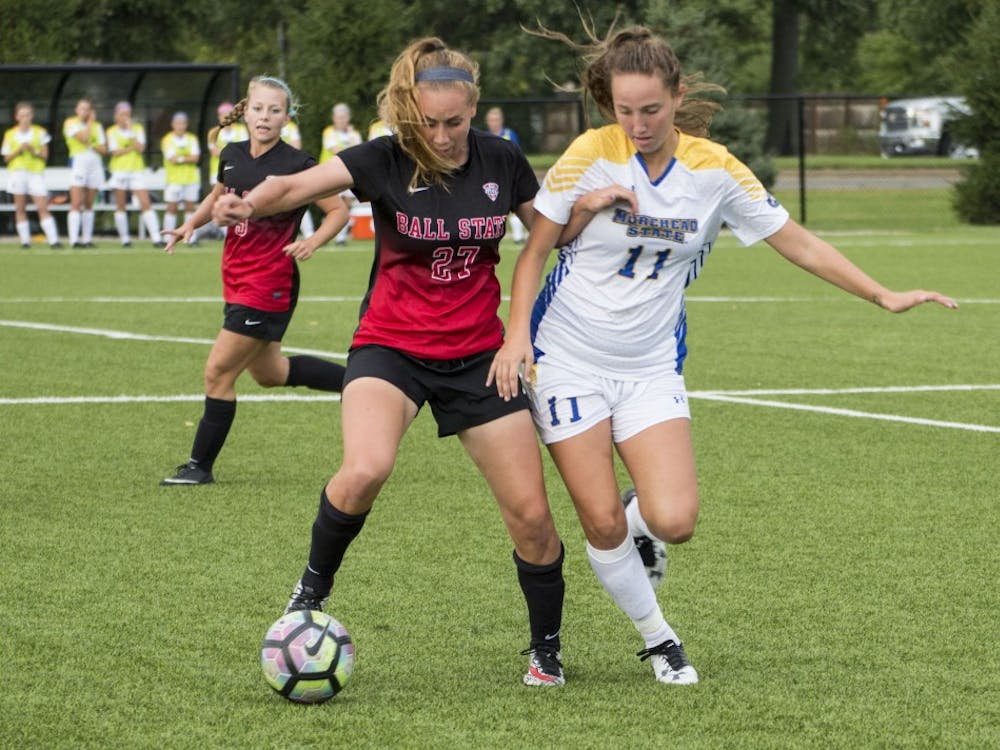 Chay McNitt, a midfielder for the Ball State soccer team, tries to steal the ball from Morehead State's midfielder Katie Quinn during the game on Sept. 16 at the Briner Sports Complex. Ball State won 4-0. Grace Ramey // DN