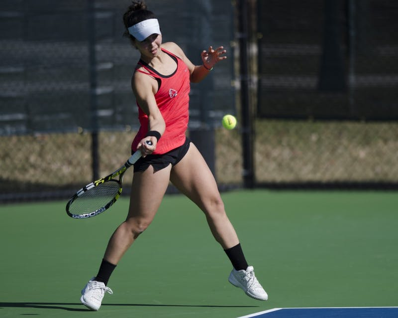 Senior Rosalinda Calderon hits a forehand during her doubles match against IUPUI on Feb. 19. Emma Rogers // DN
