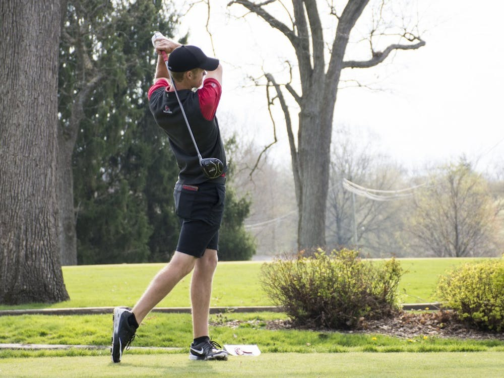 Junior Michael VanDeventer swings at the ball at hole 1 during the Earl Yestingsmeier Memorial Tournament at the Delaware Country Club on April 15. VanDeventer finished tied for first individually with a 2-under-par 208. Kaiti Sullivan // DN