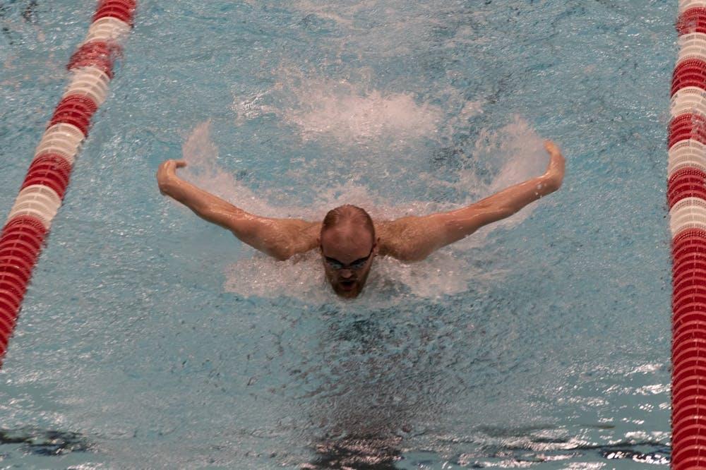 Freshman Jackson Ketcham fly swims Feb. 20, 2021, at Lewellen Aquatic Center. The Cardinals beat the Southern Illinois Sallikis 180-108. Madelyn Guinn, DN