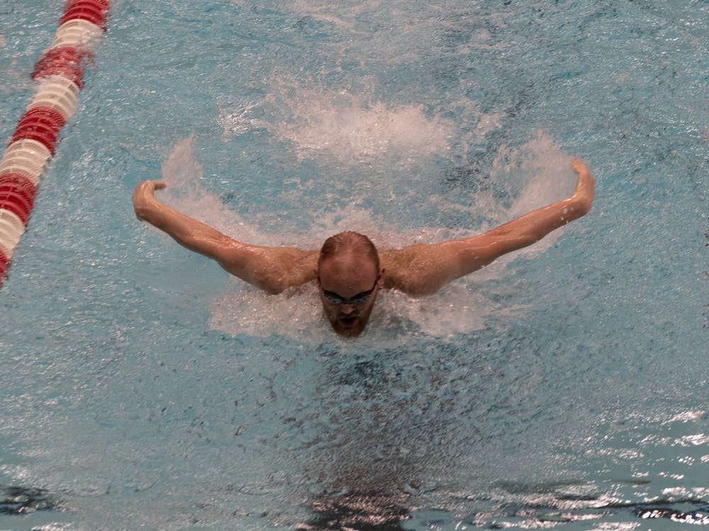 Freshman Jackson Ketcham fly swims Feb. 20, 2021, at Lewellen Aquatic Center. The Cardinals beat the Southern Illinois Sallikis 180-108. Madelyn Guinn, DN