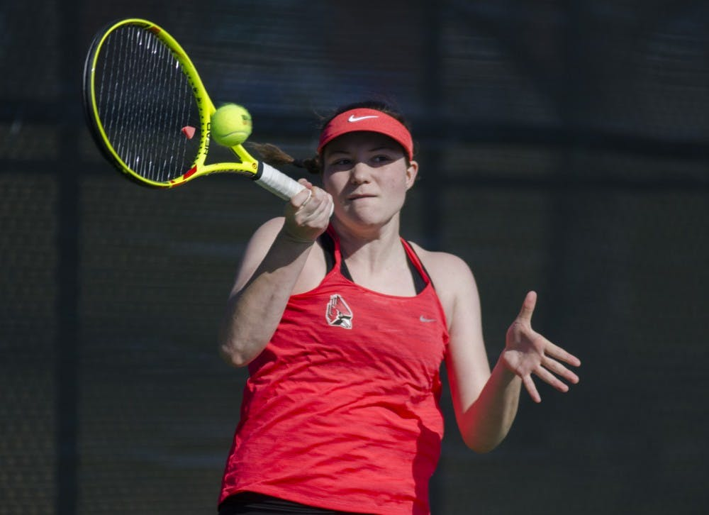 Freshman Rebecca Herrington hits a forehand during her doubles match against IUPUI on Feb. 19. Emma Rogers // DN