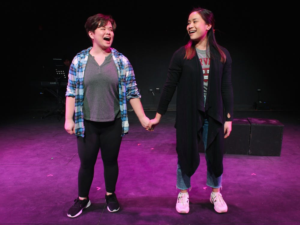 "2019 Ball State alumna Devon Hayakawa (left) holds hands with Janelle Villas (right) as they perform in ""Baked! The Musical"" at Chicago Musical Theatre Festival. ""Baked! The Musical"" featured an all Asian American cast, and the musical's writers drew from their experiences as children of immigrants in the U.S.  Underscore Theatre Company, Photo Courtesy"