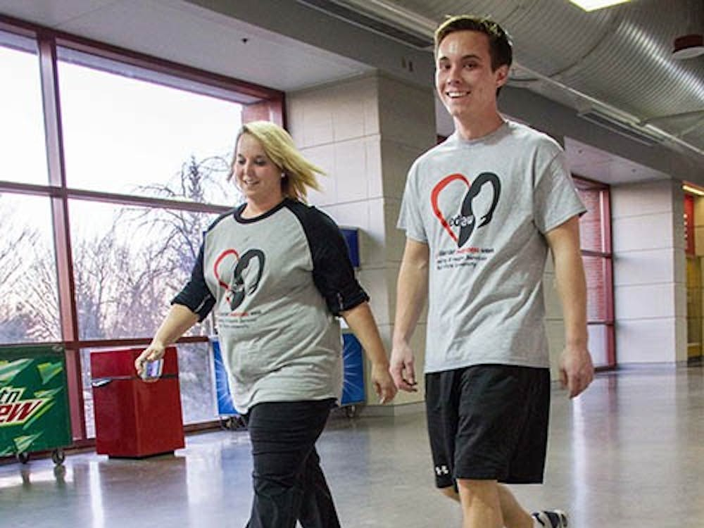 """Jason Walls, a masters student in counseling psychology, and Kodee Walls, a counseling psychology doctoral student, walk together in the """"Everybody Get Moving: Walk to Raise Awareness for Eating Disorders"""" Sunday in Worthen Arena. Other events will be hosted this week by the Counseling and Health centers such as """"Everybody's Different: Panel Discussion about Body Image and Diversity,"""" """"Healthy Eating for Everybody: How to Navigate Dining Out,"""" and """"Mirror Mirror on the Wall: How Media Messages affect Everybody."""" There are also eating disorder screenings every Sunday through Thursday at the Student Center lobby or at the Student Recreation center. DN PHOTO EMMA FLYNN"""