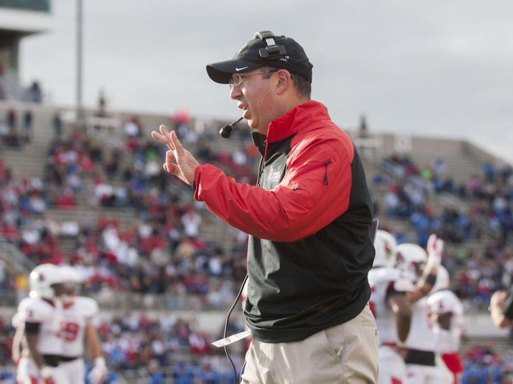 Head coach Pete Lembo talks to the refs during the game against Indiana State on Sept. 13 at Scheumann Stadium DN PHOTO TAYLOR IRBY