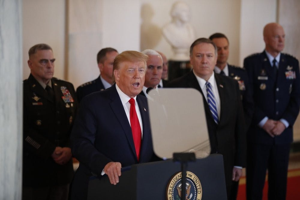 <p>President Donald Trump addresses the nation from the White House on the ballistic missile strike that Iran launched against Iraqi air bases housing U.S. troops, Wednesday, Jan. 8, 2020, in Washington, as Vice President Mike Pence, Secretary of State Mike Pompeo and military leaders, looks on. <strong>(AP Photo/Alex Brandon)</strong></p>