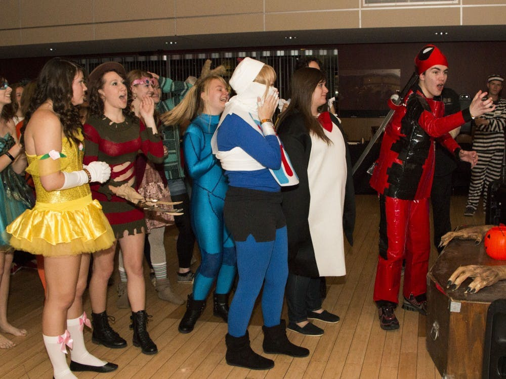 Keegan Browne reacts to winning the award for original costume during the Elliott Hall Halloween Ball. The judges said they liked his Spiderman costume, but Browne responded that he was dressed as Deadpool