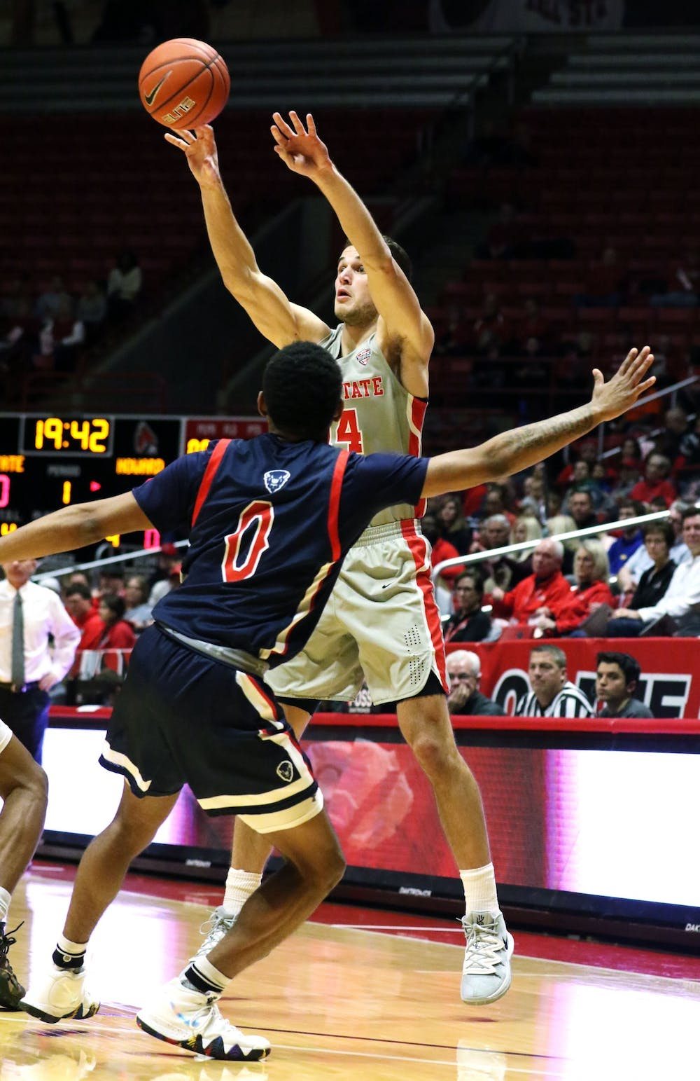 <p>Ball State senior forward Kyle Mallers passes the ball over Howard freshman guard Khalil Robinson during the Cardinals' game against the Bison Saturday, Nov. 23, 2019 at John E. Worthen Arena, Muncie, Ind. Mallers tied the program record with eight three pointers. <strong>Paige Grider, DN</strong></p>