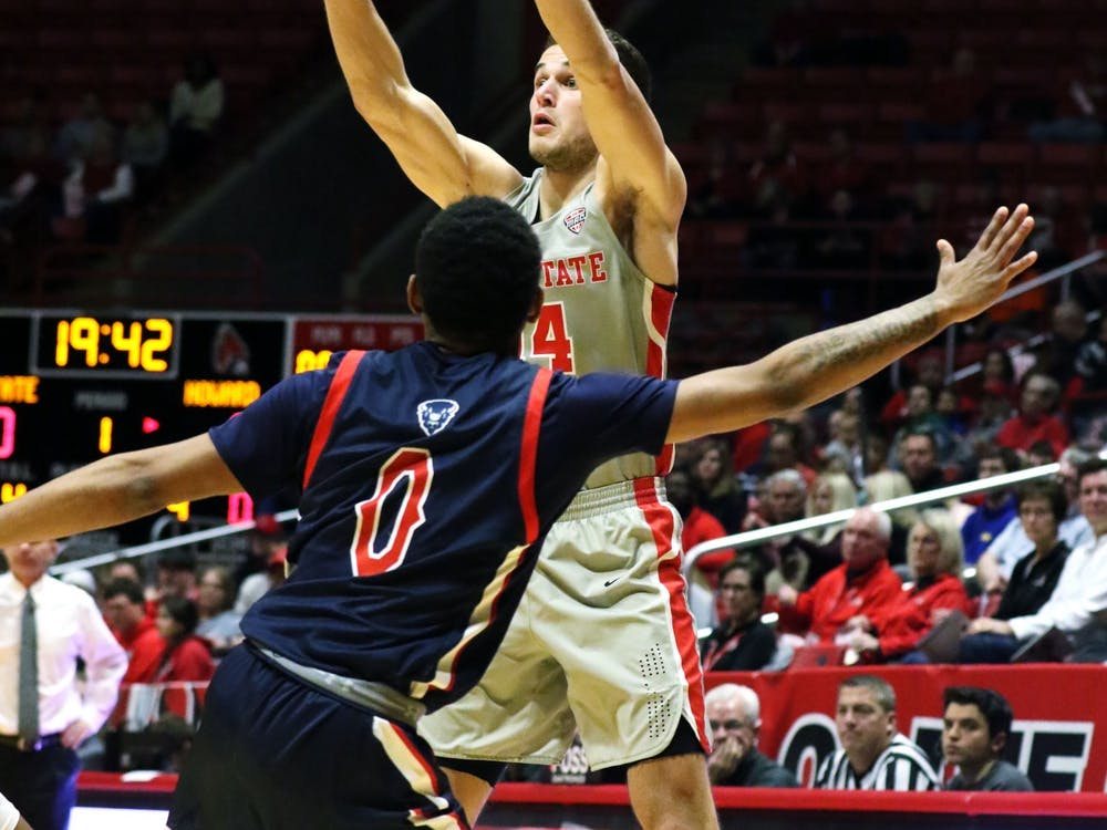 Ball State senior forward Kyle Mallers passes the ball over Howard freshman guard Khalil Robinson during the Cardinals' game against the Bison Saturday, Nov. 23, 2019 at John E. Worthen Arena, Muncie, Ind. Mallers tied the program record with eight three pointers. Paige Grider, DN