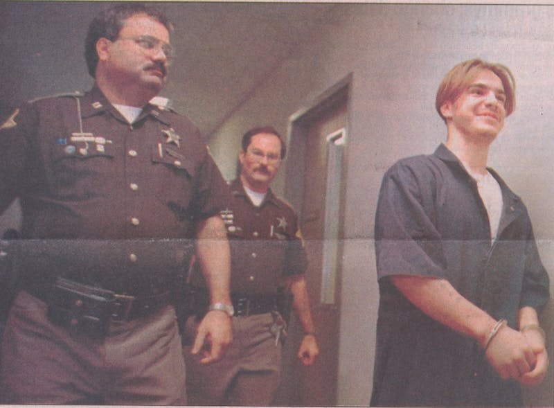 In Delaware County Superior Court 1, 18-year-old Larry Newton pleaded guilty to the September 1994 murder of sophomore Christopher Coyle near campus on Neely Avenue. Muncie Police Capt. Richard Pickett and officer David W. Hanauer escort Newton back to prison after his guilty plea hearing. Cindee Nolley, DN File