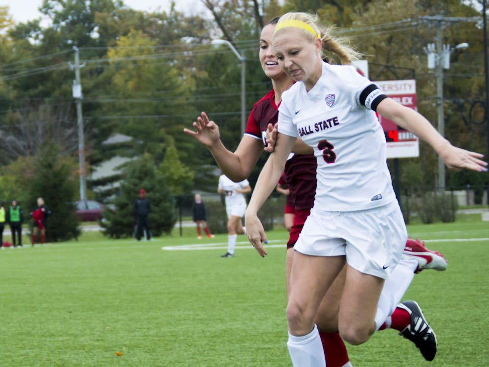 Senior defender Leah Mattingly attempts to block the ball from Northern Illinois University on Oct. 30 at the Briner Sports Complex. The soccer team went on to lose 1-1(4-3) (DN PHOTO Terence K. Lightning Jr.)