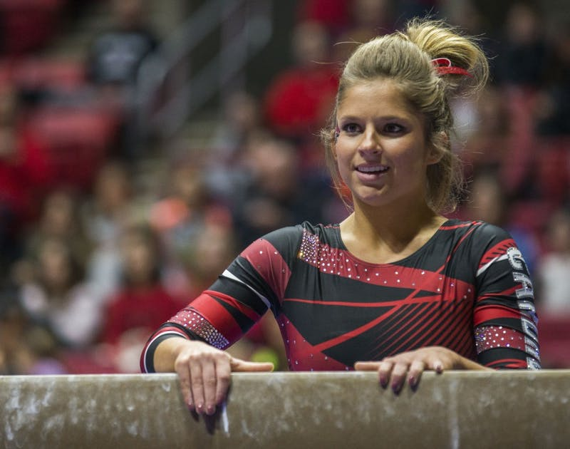 Junior Baylee Bell prepares to start her routine on the balance beam during the meet against Northern Illinois on Jan. 15 at Worthen Arena. Breanna Daugherty // DN