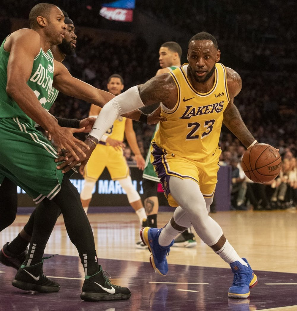 The Los Angeles Lakers' LeBron James (23) drives to the basket as the Boston Celtics' Al Horford defends in the fourth quarter at Staples Center in Los Angeles on Saturday, March 9, 2019. The Celtics won, 120-107. (Brian van der Brug/Los Angeles Times/TNS)