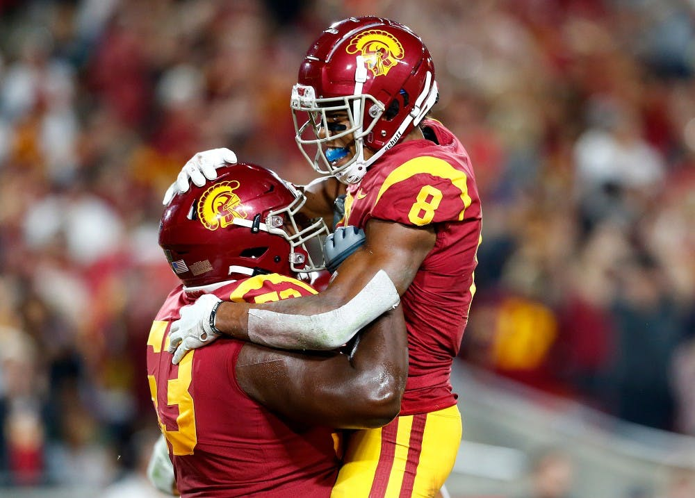 USC wide receiver Amon-Ra St. Brown (8) is congratulated by teammate Drew Richmond after scoring a touchdwon against Stanford in the second quarter at the Los Angeles Memorial Coliseum on Saturday, Sept. 7, 2019. (Luis Sinco/Los Angeles Times/TNS)