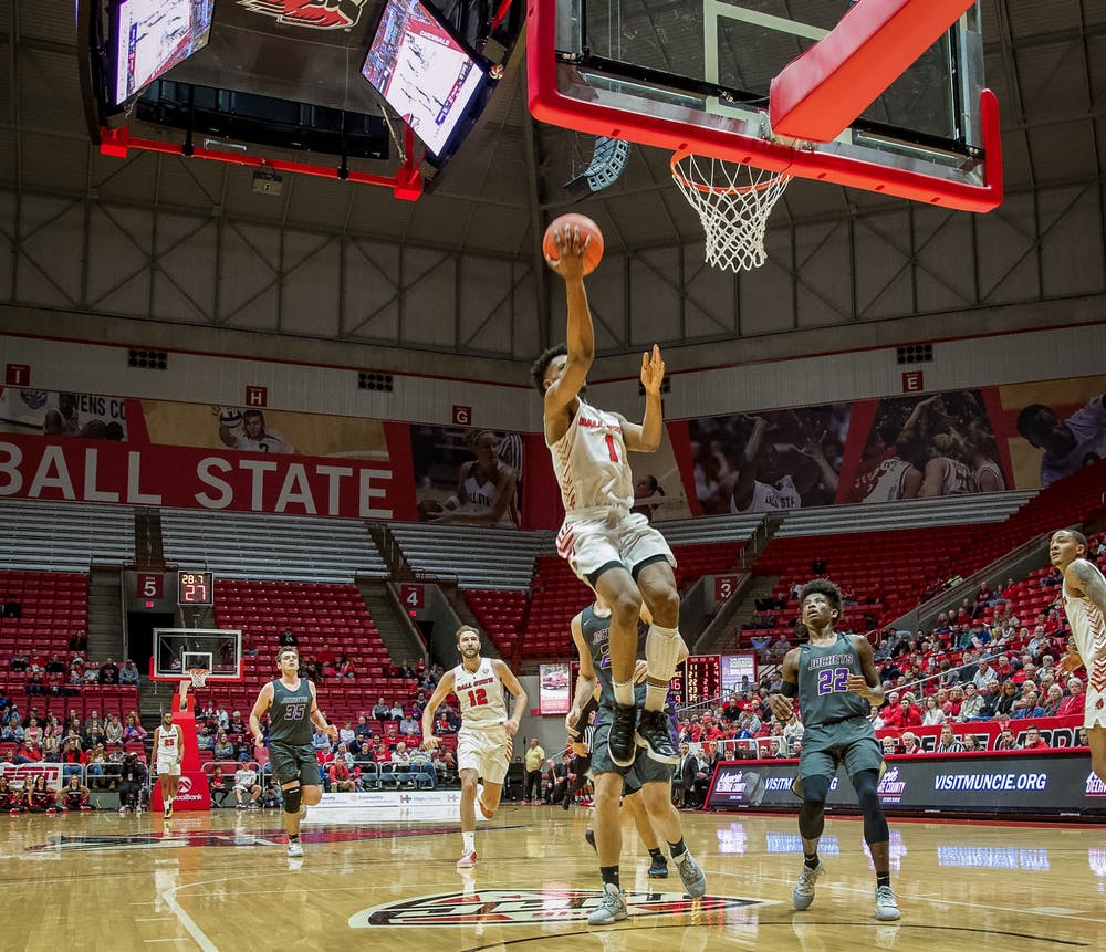 <p>Redshirt senior guard, K.J. Walton (1), lays the ball up on a fastbreak against Defiance on Nov. 5, 2019, at John E. Worthen Arena. Walton finished with 11 points as the cardinals cruise to an 87-43 win. <strong>Omari Smith, DN</strong></p>