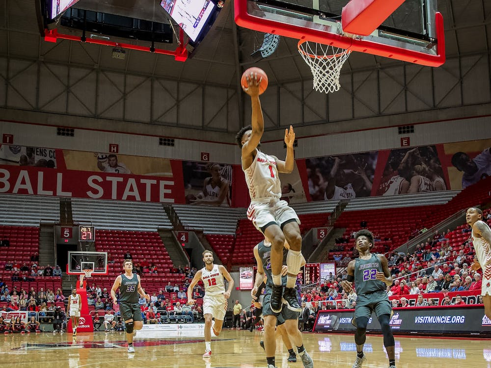 Redshirt senior guard, K.J. Walton (1), lays the ball up on a fastbreak against Defiance on Nov. 5, 2019, at John E. Worthen Arena. Walton finished with 11 points as the cardinals cruise to an 87-43 win. Omari Smith, DN
