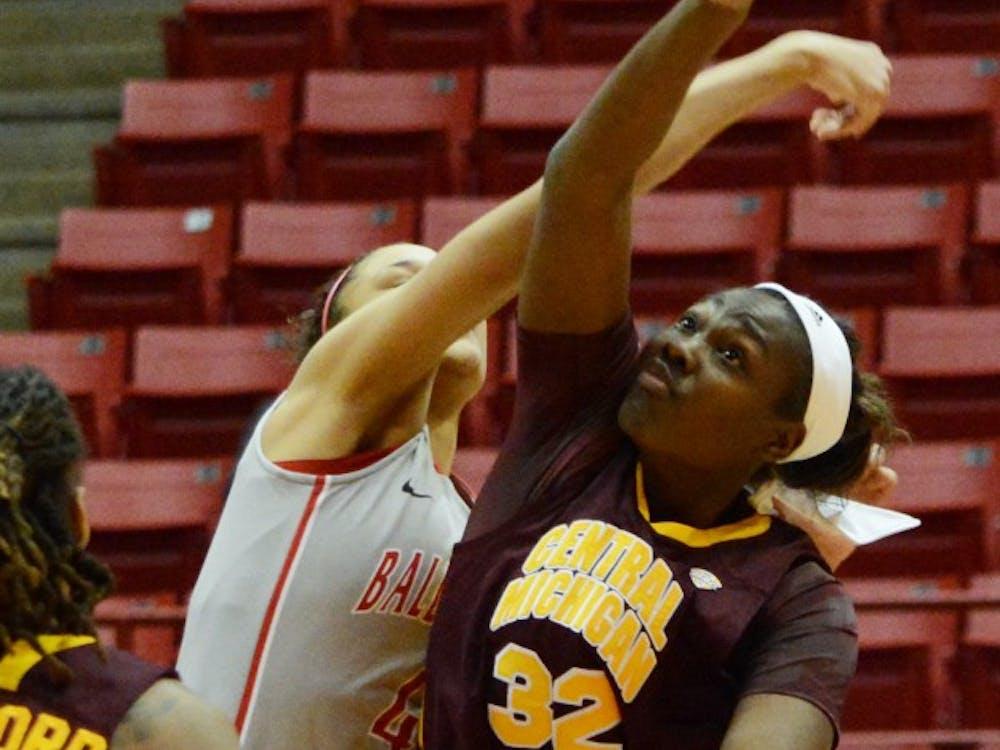 Junior Jas'Mine Bracey of Central Michigan attempts a shot against Ball State guard Nathalie Fontaine Feb. 6 in Worthen Arena. DN PHOTO SAMANTHA BLANKENSHIP