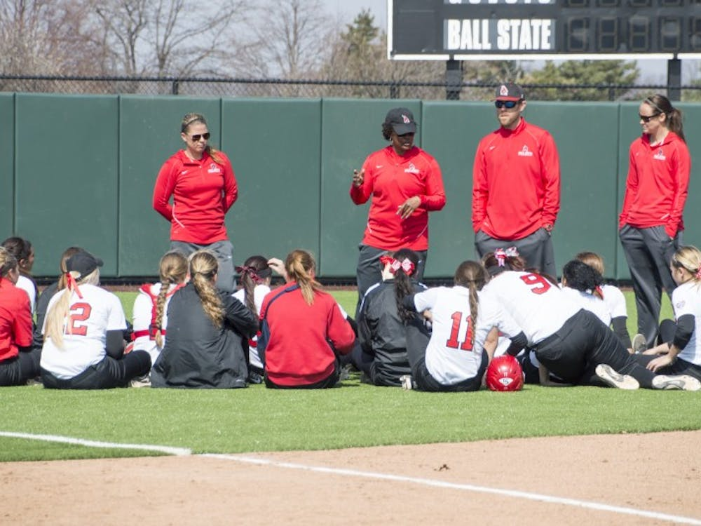 Ball State head coach Tyra Perry talks to the softball team after the first game of the double header against Western Kentucky at First Merchants Ballpark Complex on March 21. DN PHOTO ALAINA JAYE HALSEY