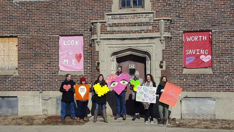 Heart Bombers decorated the former Wilmore Apartments at 424 W. Main Street on Saturday, Feb. 10 in downtown Muncie. The goal of Heart Bombing is to decorate historical buildings in the area to bring attention to its significance. Evan Weaver, DN