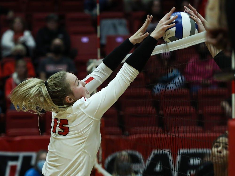 Freshman setter Megan Wielonski (15) blocks the ball against Northern Illinois at Worthen Arena Oct. 16. Ball State will take on Toledo at Worthen Arena Oct. 19. Jacy Bradley, DN