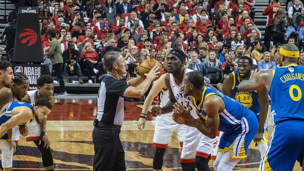 Toronto Raptors forward Pascal Siakam prepares for tip-off against Golden State Warriors forward Andre Iguodola during Game 2 of the 2019 NBA Finals June 2, 2019. The Warriors appeared in five consecutive NBA Finals from 2015 to 2019, earning three championships. Chensiyuan, Photo Courtesy