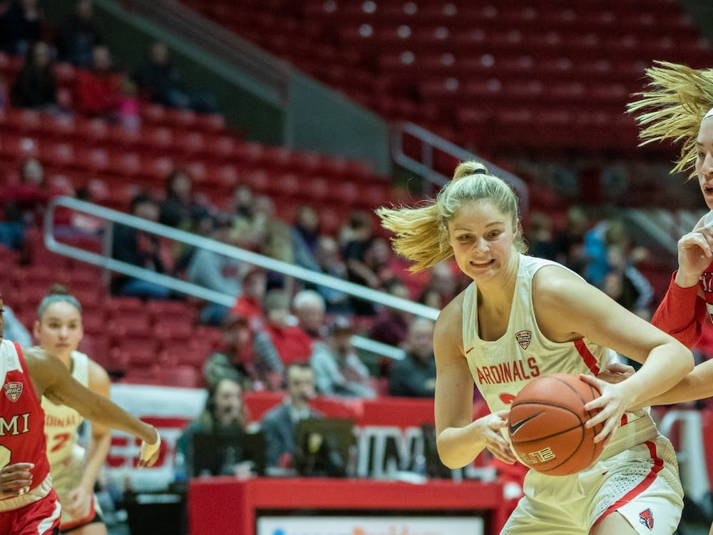 Sophomore guard Blake Smith takes the ball from Junior forward Kelly McLaughlin, Jan. 25, 2020, in John E. Worthen Arena. Smith had eight points for the Cardinals. Jacob Musselman, DN