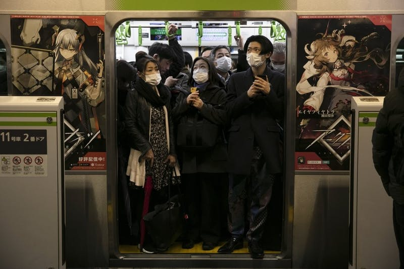 Commuters wearing masks stand in a packed train at the Shinagawa Station March 2, 2020, in Tokyo. Coronavirus has spread to more than 60 countries, and more than 3,000 people have died from the COVID-19 illness it causes. (AP Photo/Jae C. Hong)
