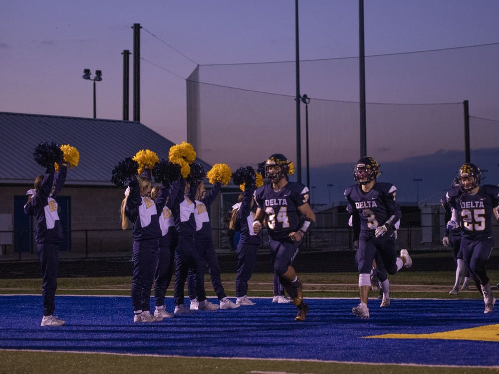 Delta football players run onto the field prior to their home game vs. Wayne Oct. 30, 2020, at Delta High School. The Eagles defeated the Generals 49-18. Connor Smith, DN.