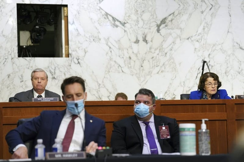 Sen. Lindsey Graham, R-S.C., left, and Sen. Dianne Feinstein, D-Calif., listen during a confirmation hearing for Supreme Court nominee Amy Coney Barrett before the Senate Judiciary Committee, Monday, Oct. 12, 2020, on Capitol Hill in Washington. (Erin Schaff/The New York Times via AP, Pool)