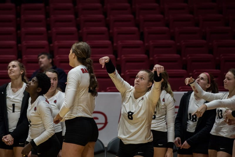 Ball State's women's volleyball bench signals the ball was in as they watch a review on the big screen Oct. 12, 2018, in John E. Worthen Arena. Ball State defeated Ohio University 4-1putting the Cardinals 15-5 overall in the season. Eric Pritchett,DN