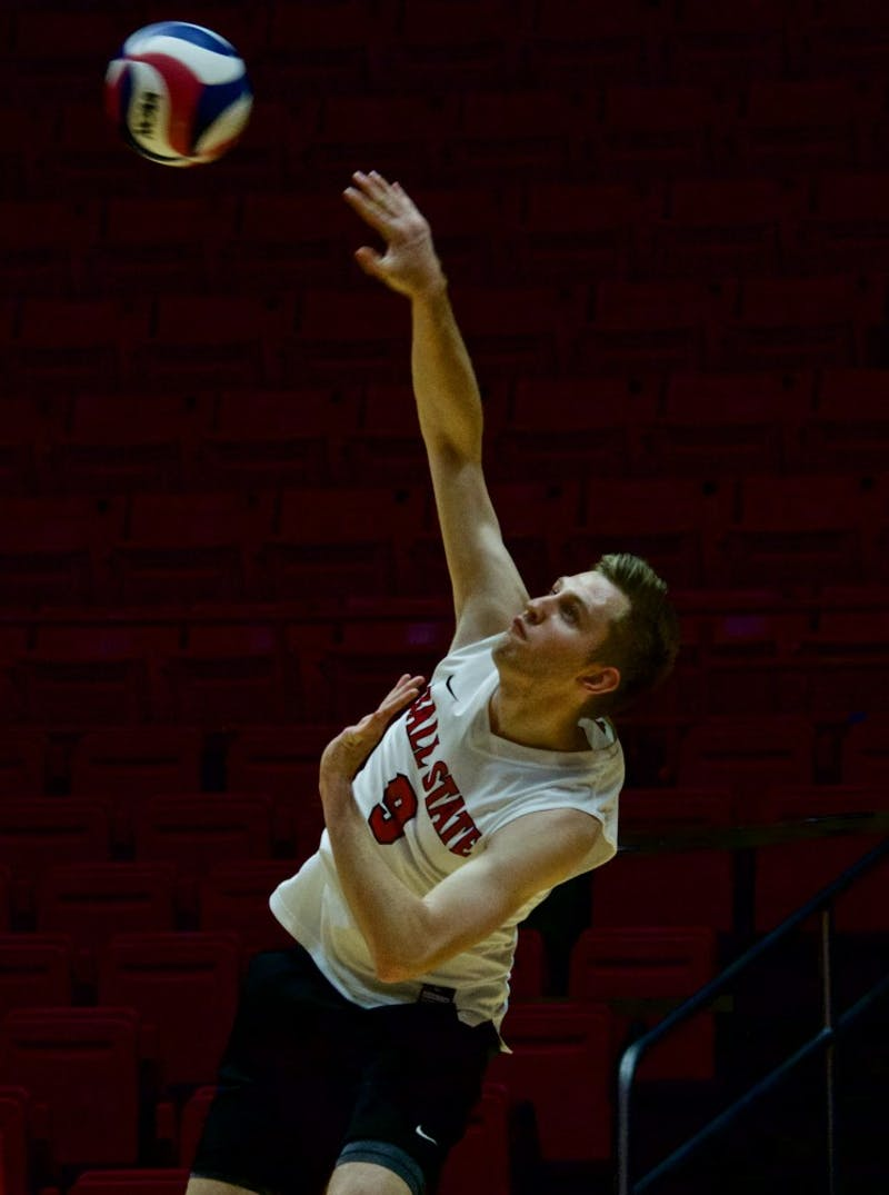 Junior Parker Swartz serves the ball for the Cardinals against Quincy on March 31 at John E. Worthen Arena. Ball State won three games in a row. Rebecca Slezak, DN