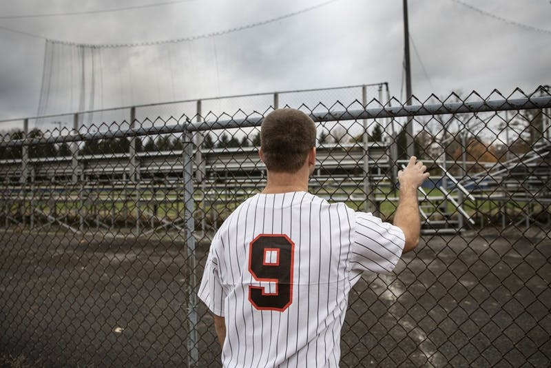 Zach Piatt stands outside the McCulloch Park baseball dimond Nov. 6, 2018. Piatt played his last season of baseball in 2017. Rebecca Slezak,DN