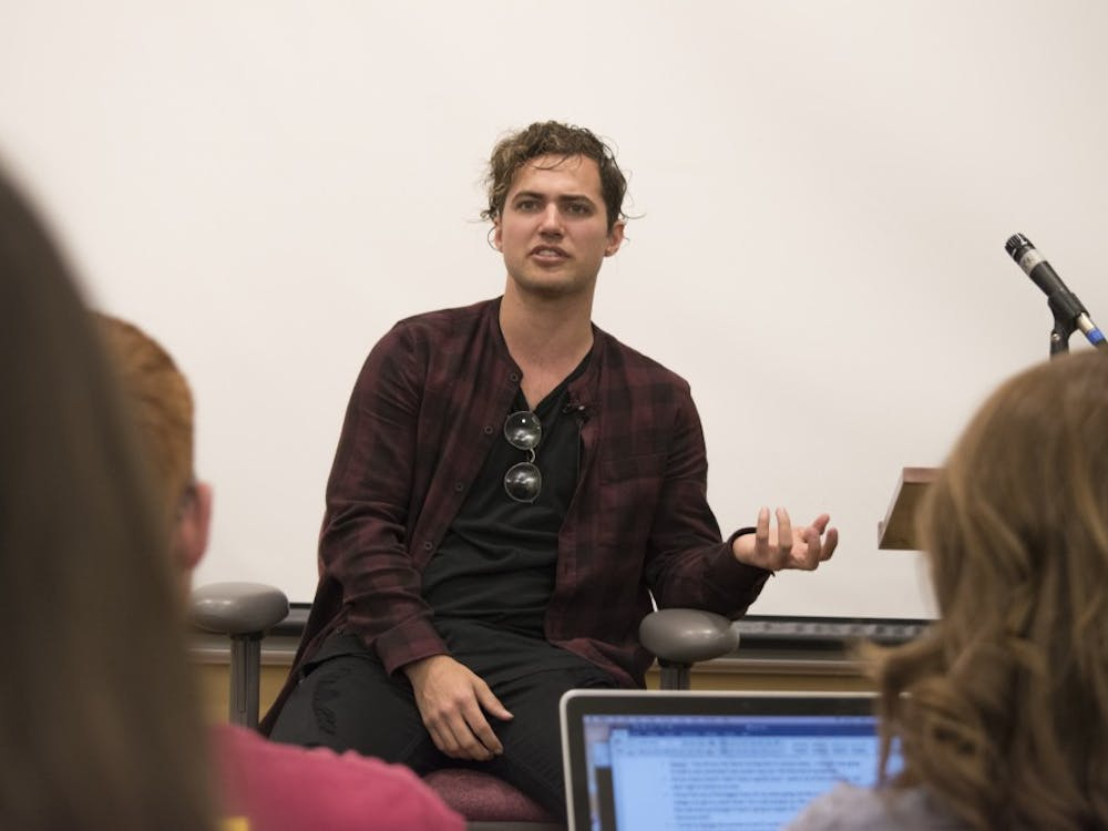 Kevin Ray, bass player for Walk the Moon, visits Ball State University on April 20, in the Letterman Building room 125 to talk about his experiences before and after entering into the music business. DN PHOTO STEPHANIE AMADOR