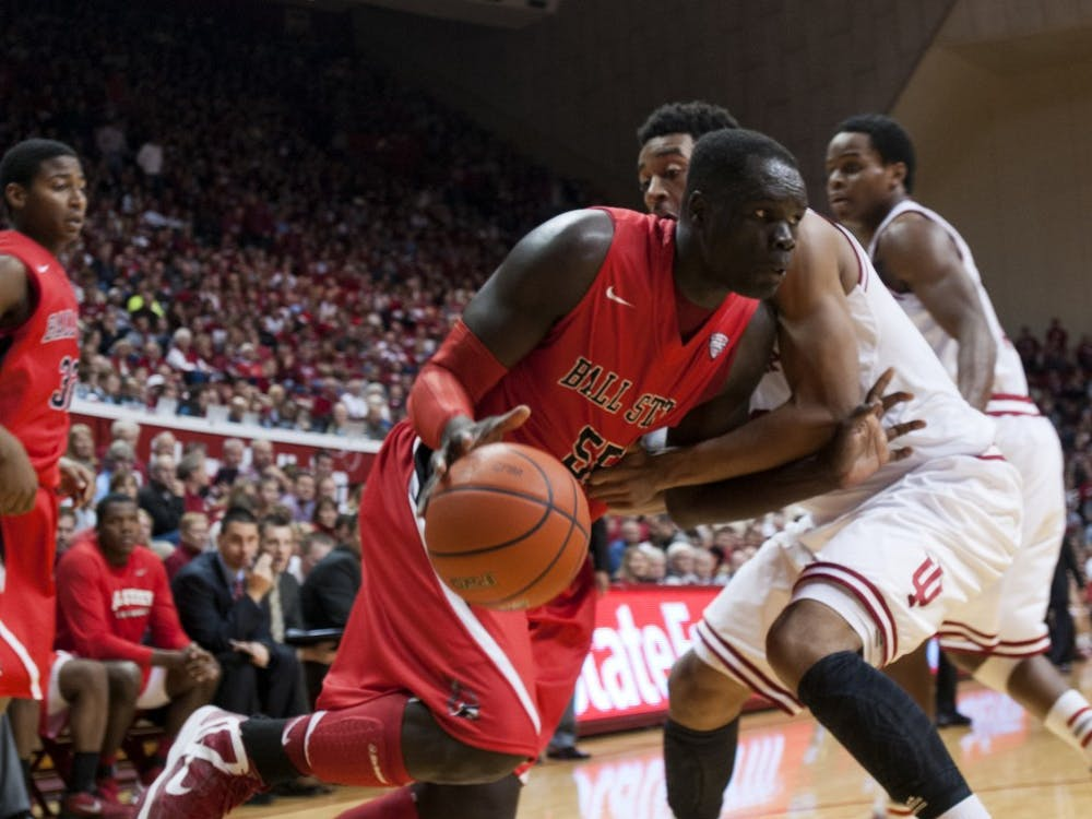 Senior forward Majok Majok attempts to push past an Indiana defender during the second half of the game on Nov. 25, 2012. Majok was a third-team All-MAC selection last season, making him a prominent player this season. DN FILE PHOTO BOBBY ELLIS