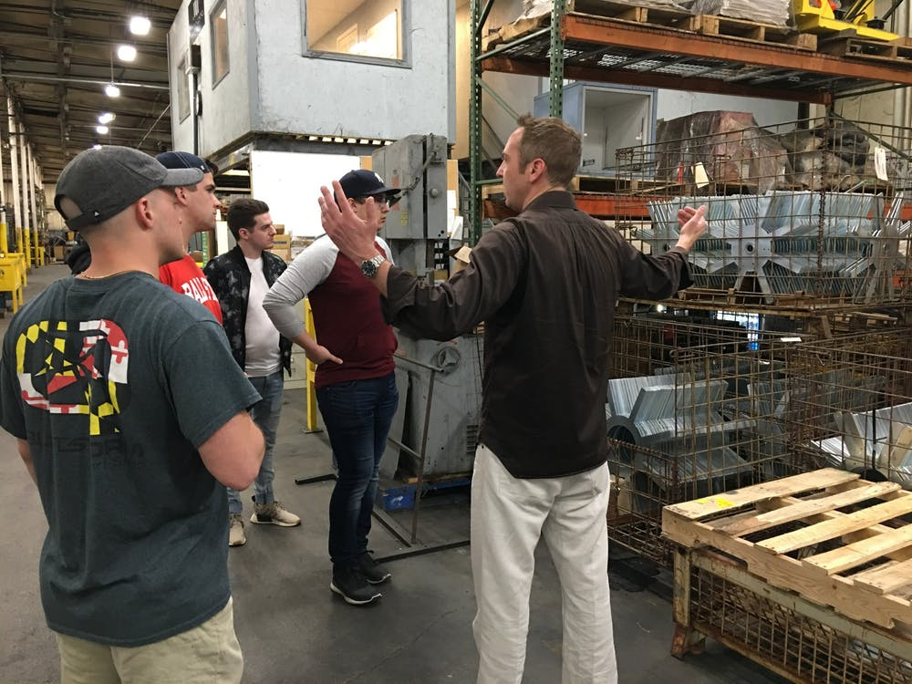 John Smith, president of the industrial division at Mid-West Metal Products, talks to students in the MadJax studio fall 2019. Mid-West Metal Products is based in Muncie and provided materials for the Minnetrista farmers market project. Kevin Klinger, Photo Provided