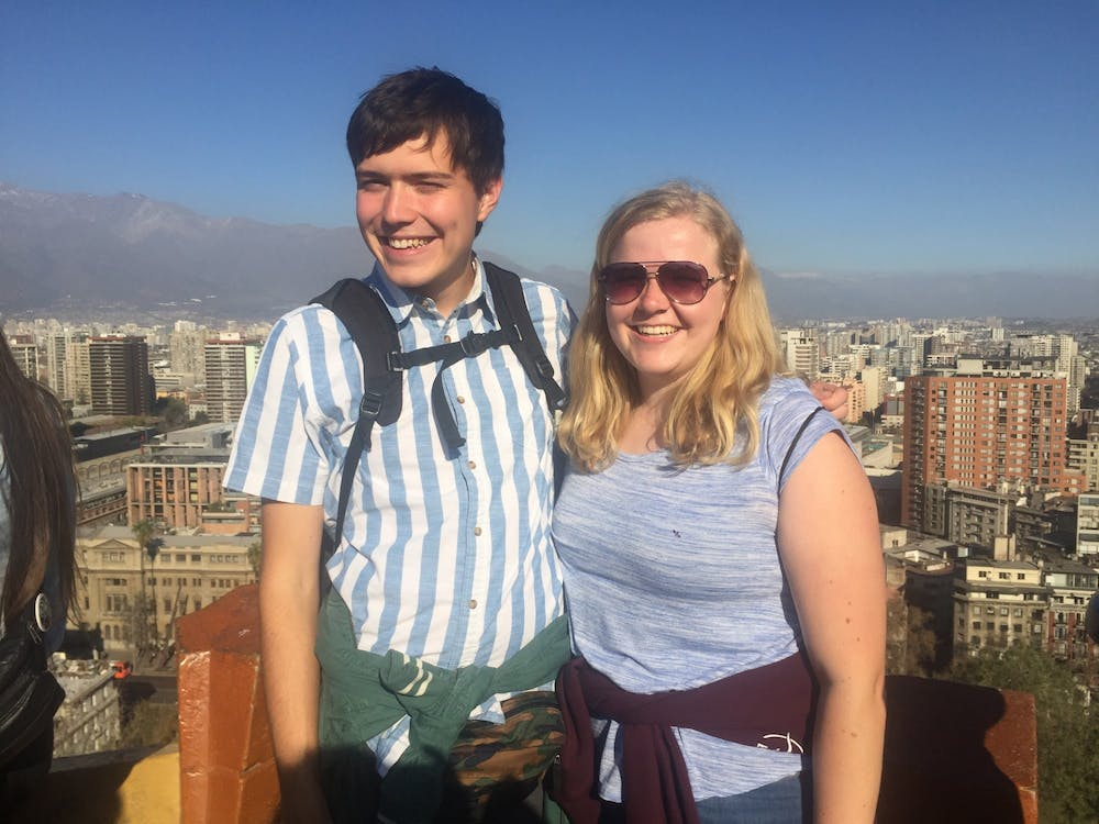 <p>Max Fellabaum and Grace Brenner pose above the city of Santiago, Chile. Fellabaum said there were many times he could see himself living in Chile. <strong>Grace Brenner, Photo Provided</strong></p>