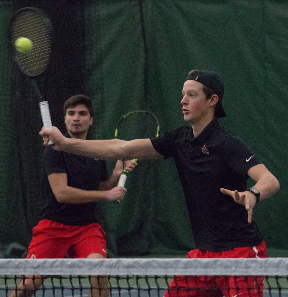 <p>Junior Nemanja Guzina, left, and freshman Thibault de Negri, right, in a doubles match against IU Southeast at Northwest YMCA in Muncie, Ind. Feb. 3. <strong>Eric Pritchett, DN</strong></p>