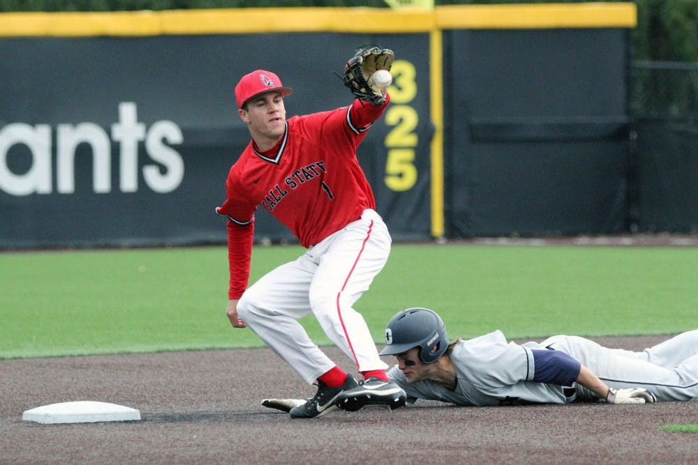 <p>Second baseman Seth Freed attempts to get a Dayton runner out at second during the Cardinals' game against the Flyers on March 18 at Ball Diamond at First Merchants Ballpark Complex. <strong>Paige Grider, DN File</strong></p>