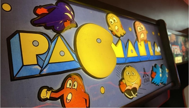 "A classic ""Pac-Mania"" arcade game sits in Fud's Retro Arcade in Muncie. Chris Wallace added an arcade to his business Fud's Video Games in November 2019. Garrett Chorpenning, DN"