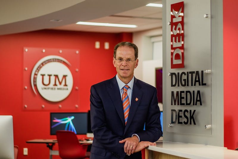President Geoffrey S. Mearns poses for a picture in the Unified Media Lab within the Art and Journalism Building on Aug. 9, 2017. Reagan Allen, DN