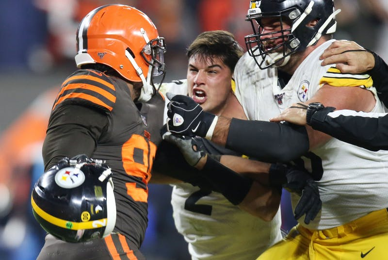 Cleveland Browns defensive end Myles Garrett prepares to swing the helmet of Pittsburgh Steelers quarterback Mason Rudolph at Rudolph during a fight in the second half, November 14, 2019, at FirstEnergy Stadium. (John Kuntz, cleveland.com/cleveland.com, TNS)