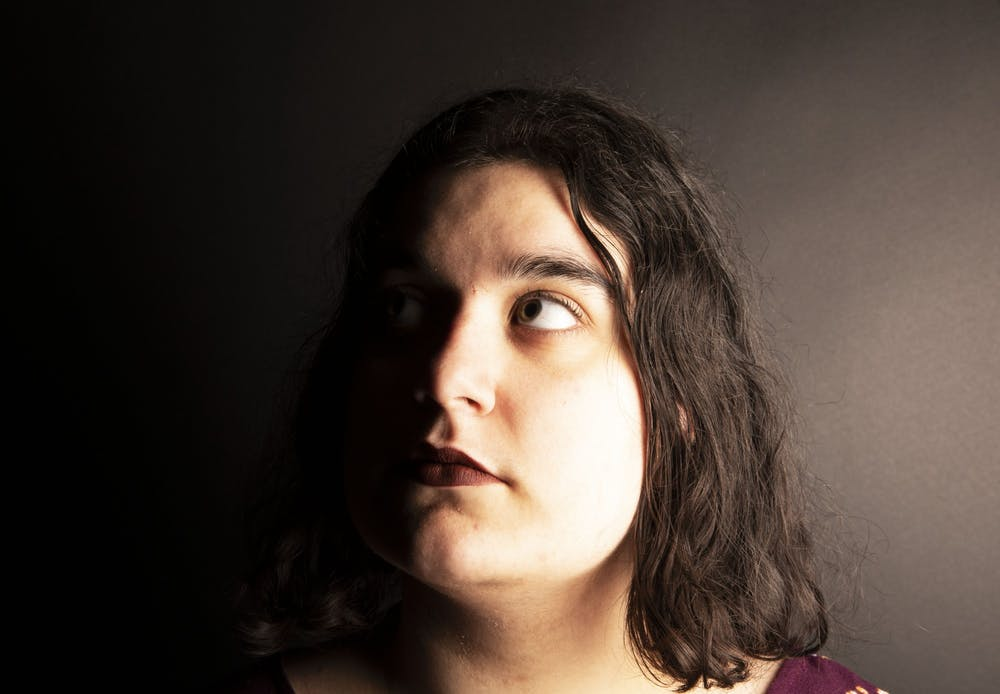 <p>Elena Stidham poses in the studio March 10, 2020. Stidham's mother was born in Iraq and her father was born in Michigan. <strong>Jacob Musselman, DN Illustration</strong></p>