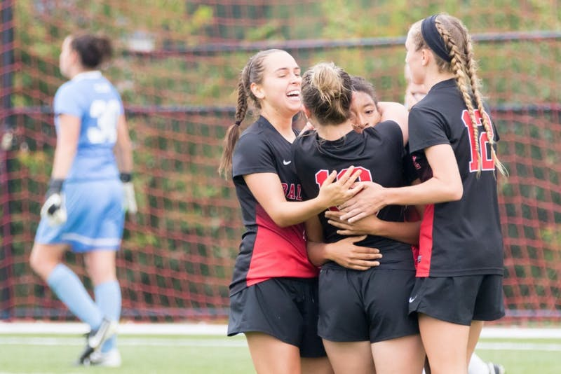 The Cardinals celebrate after scoring a goal during the game against Toledo at the Briner Sports Complex on Oct. 16. Kyle Crawford // DN