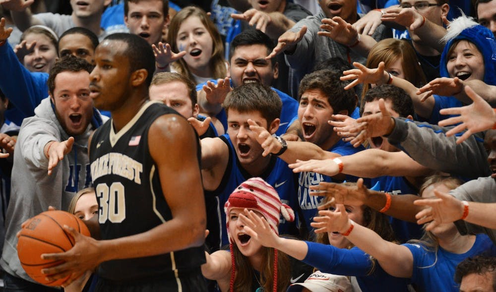 Cameron Crazies taunt Wake Forest forward Travis McKie (30) as he inbounds the ball in the first half of play. The Duke Blue Devils defeated the Wake Forest Demon Deacons, 83-63, at Cameron Indoor Stadium in Durham, N.C., on Tuesday, Feb. 4, 2014. (Chuck Liddy/Raleigh News & Observer/MCT)
