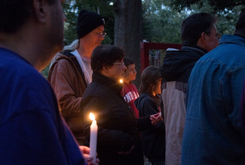 Friends and family gather around at West Side Park in Muncie Oct. 16, 2018. The vigil was in remembrance of Joe Minor Jr. who died from a hit-and-run on Oct. 6, 2018. Carlee Ellison, DN