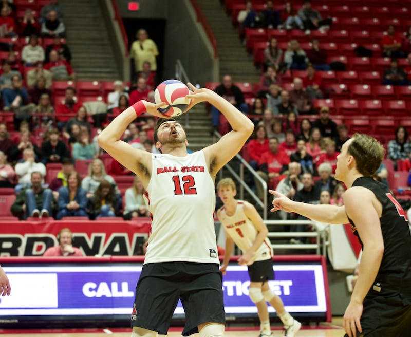 Senior setter Jake Romano sets the ball Jan. 11 in John E. Worthen Arena. In the Cardinals' second and final match of the Active Ankle Challenge, Ball State swept Queens. Jacob Musselman, DN